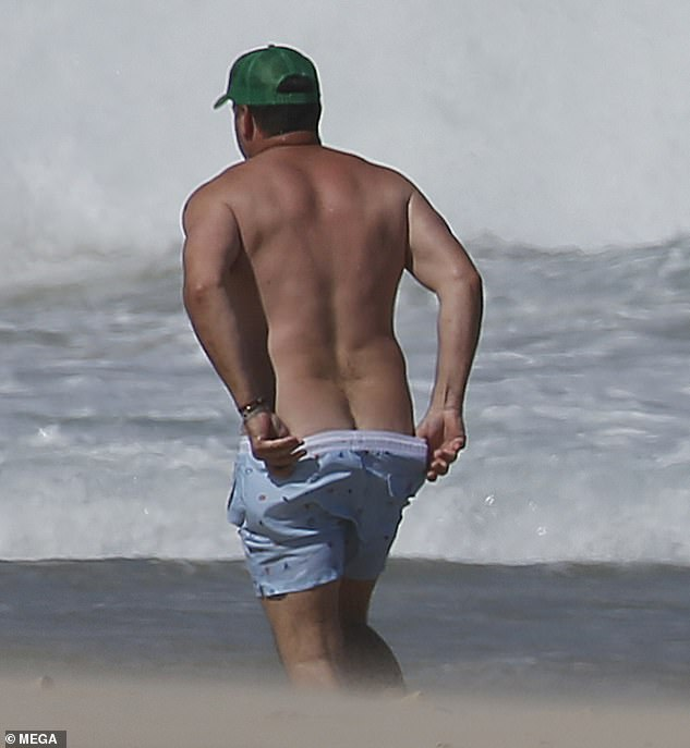 Not again! Following the quick dip, Karl gave beachgoers another glimpse of his buttocks as he readjusted his swimmers while walking along the beach