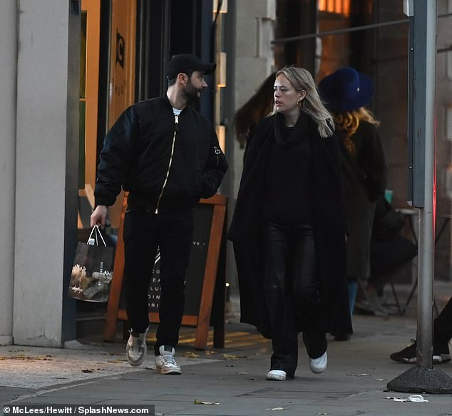 Out and about:Tanya Burr appeared in great spirits as she enjoyed a low-key outing in London's Notting Hill with a mystery male companion on Saturday