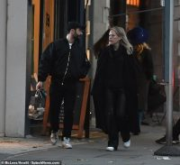 Tanya Burr dons an all-black ensemble as she enjoys a low-key outing with a male friend in London