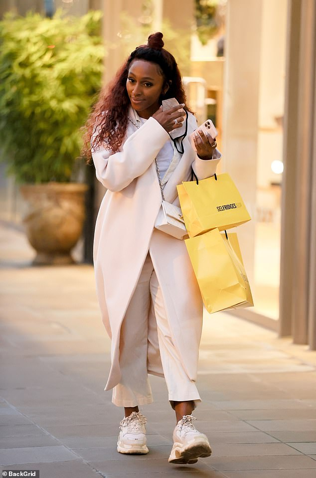 All smiles: Alexandra Burke appeared to be in great spirits as she stepped out to do a spot of Christmas shopping in Chelsea, London, on Saturday