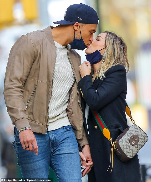 Romantic stroll: Clare Crawley pulled down her face mask Friday and shared a smooch with her handsome fiancé Dale Moss, as they took a romantic stroll through New York City