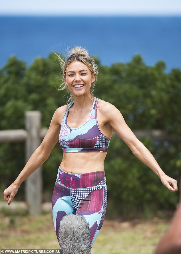 A look:The 31-year-old showed off her gym-honed figure in an abstract activewear set as she waited between takes