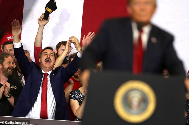 Lindell is a frequent supporter of Trump and his administration. Pictured: Lindell cheering during a North Dakota campaign rally hosted by Trump