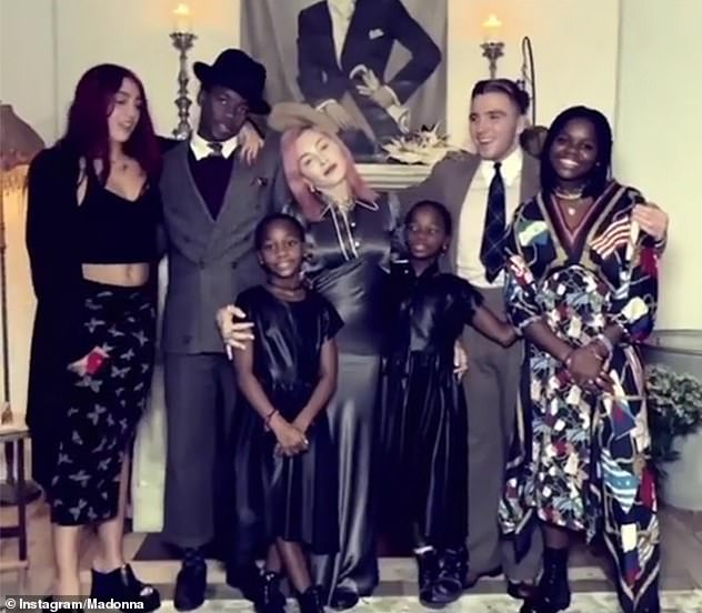 Strong bond: The entertainer shared a rare photo of all six of her children during Thanksgiving last month (L-R: Lourdes, 24,David, 15, Estere and Stella, Rocco, 20, and Mercy James)