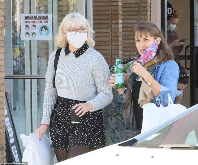 Mack is seen with her friend after they shopped for a half hour and grabbed a bite of food during the outing