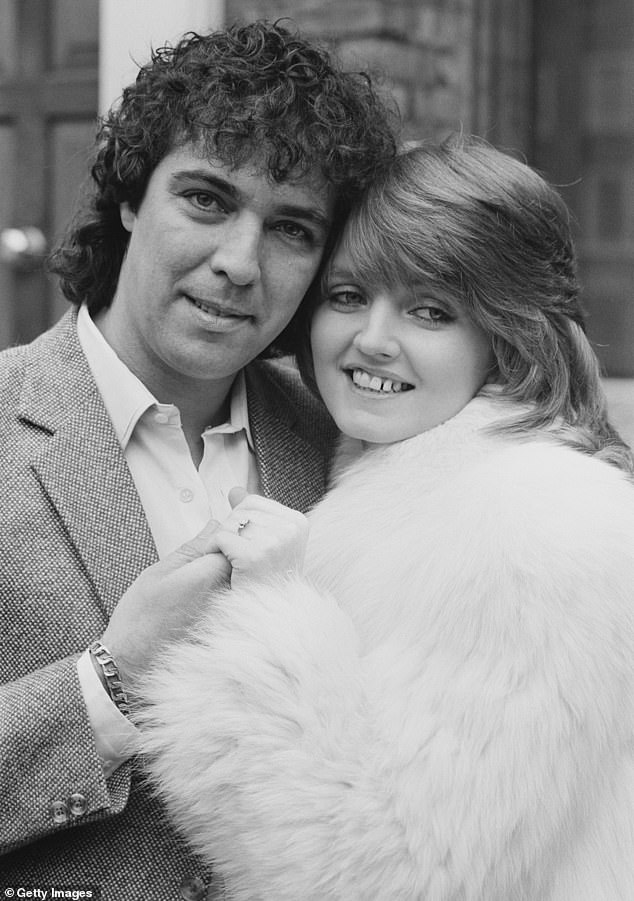 Love: The star also revealed that she even started dating a bit as it would be nice to have someone to hang out with (pictured with husband Brian, who died in 2007)