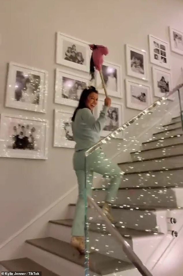 Kourtney Kardashian gallops around on a 'little christmas pony' plush in hilarious TikTok video
