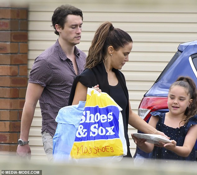 Out and about:Neighbours star Jodi Gordon enjoyed lunch with her new boyfriend, Sebastian Blackler, and her daughter, Aleeia, in Sydney on Monday. All pictured