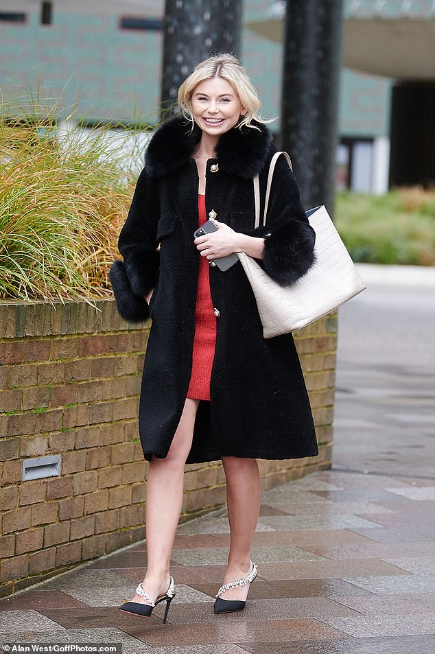 Ever so chic! Georgia Toffolo, 25,  displayed her endless pins in a festive red mini dress and a fur-collared coat as she exited ITV Studios in London on Monday