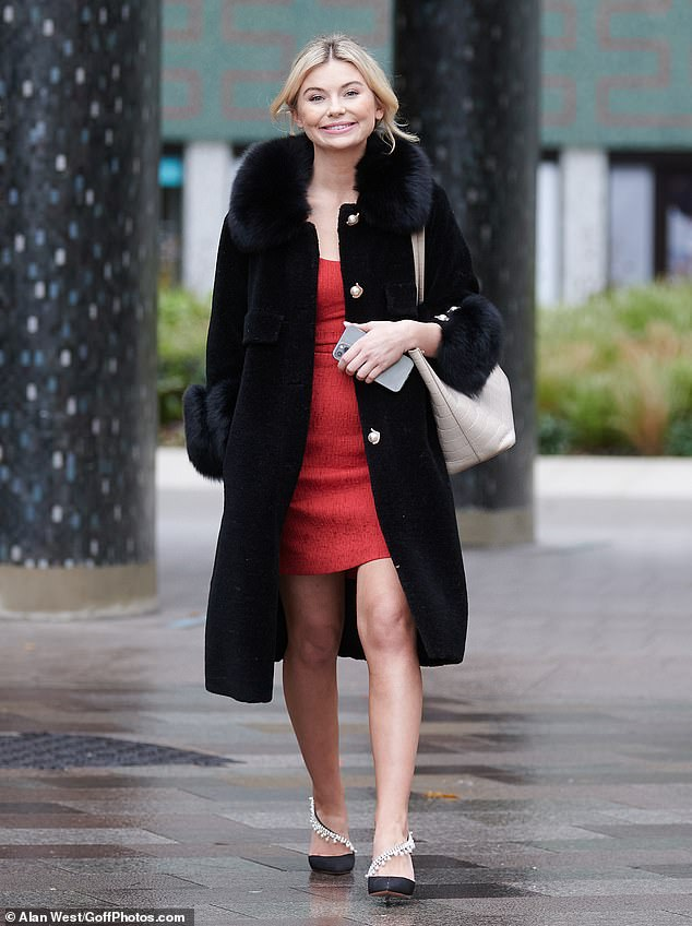 Looking good: The former Made In Chelsea star cut a stylish figure as she strolled out of Television Centre in the cosy ensemble after making a guest appearance on This Morning
