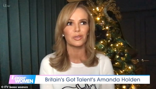 'He feels on top of the world... and he looks fantastic': Amanda Holden told Loose Women on Monday that Simon Cowell WILL return to Britain's Got Talent in the new year