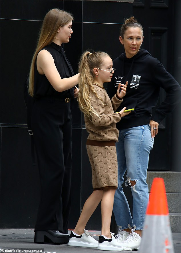 They grow up so fast:Bec's eldest daughter Mia, 15, towered over her mother in a pair of chunky boots