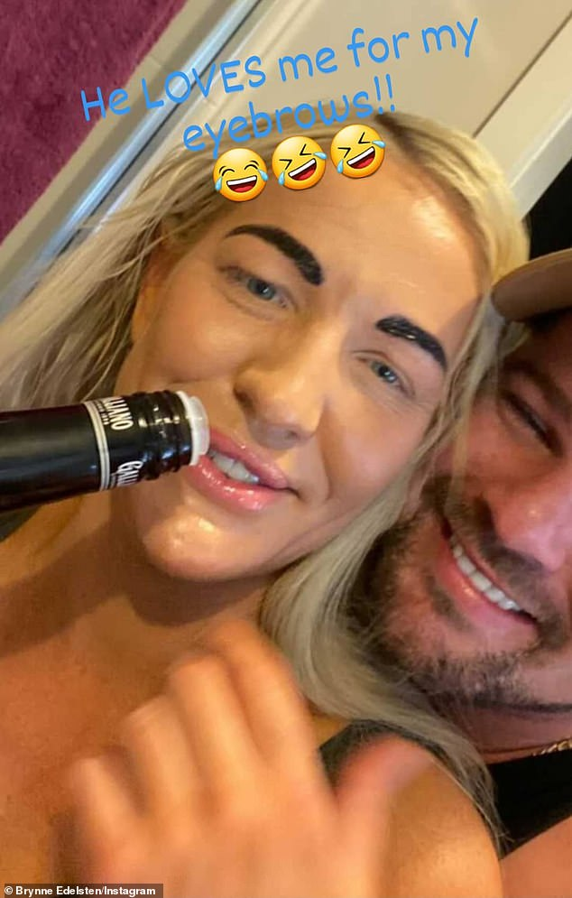 New look: Brynne Edelsten revealed her very bold eyebrows as she posed for a selfie with a mystery man.Her black eyebrows contrasted her peroxide blonde locks, but it is likely she was doing a tinting treatment in order for them to look slightly darker than her tresses