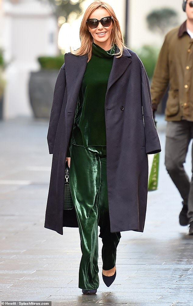 Feeling festive: The TV and radio star, 49, exuded glamour in an emerald green velvet co-ord as she headed home following her Heart FM show