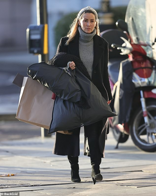 Casual: Rachel Stevens cut a casual figure in a grey roll-neck jumper and black jacket as she stepped out in London on Tuesday ahead of her final Cabaret All Stars show