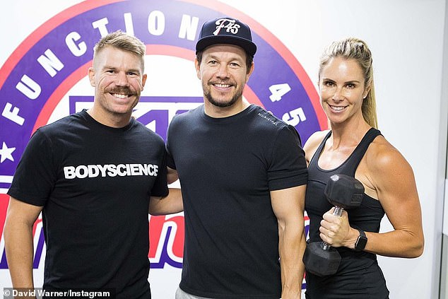 How cool is this!David's post comes after he admitted to 'fanboy-ing' over Hollywood actor Mark Wahlberg (centre) in Woolloomooloo, Sydney, on Tuesday