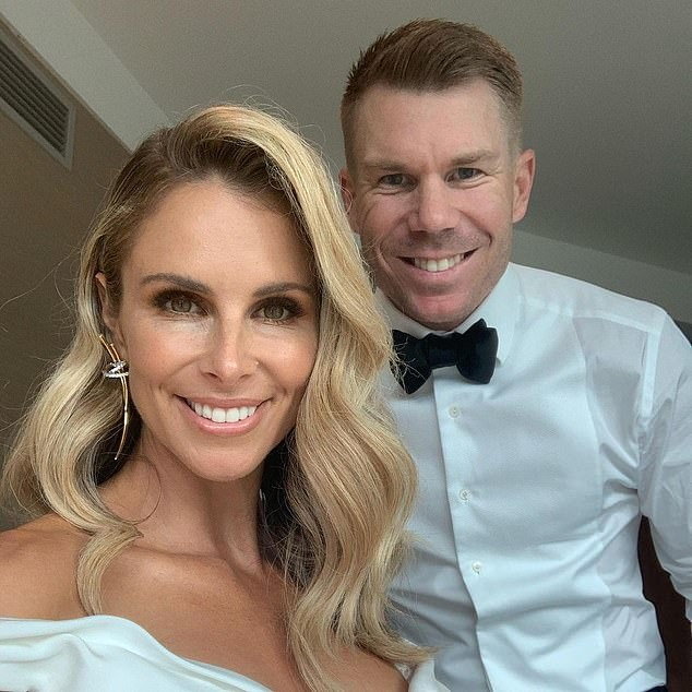 Feeling festive: David Warner (right) certainly seems to be excited to spend the holidays with his wife, Candice, and their daughters, Ivy Mae, six, Indi Rae, four, and 18-month old Isla Rose