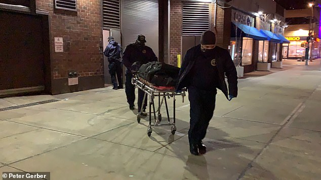 A New York City supermarket employee has been crushed to death by a freight elevator while on the job. Police are seen removing her body from the store on Tuesday evening