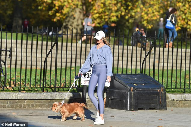 Out and about: The entrepreneur maintained her sporty appearance when it came to her choice of footwear as she teamed her outfit with white trainers