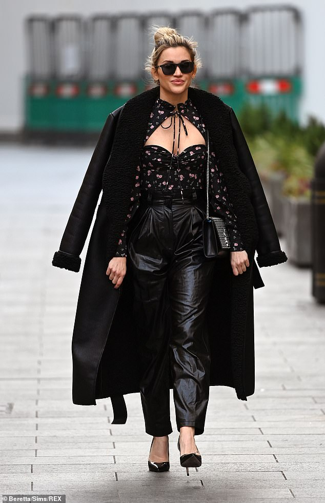 All black everything:She boosted her height with a pair of pointed black heels while she kept warm with a long black shearling coat which was draped over her shoulders