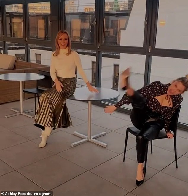 Hilarious: Asley larked around in the fun clip as she and Amanda shared a laugh at work