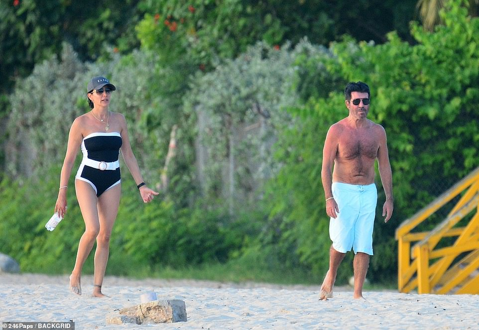 Sensational: Lauren highlighted her incredible physique in the black and white strapless swimsuit