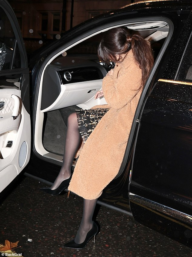 Graceful entrance: She showed off a hint of her glam dress as she climbed into the car
