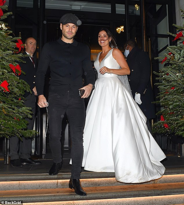 Star struck:Michelle led the way out of the hotel, while Mark followed behind, after shocking a star-struck bride who was stood in the entrance of the hotel