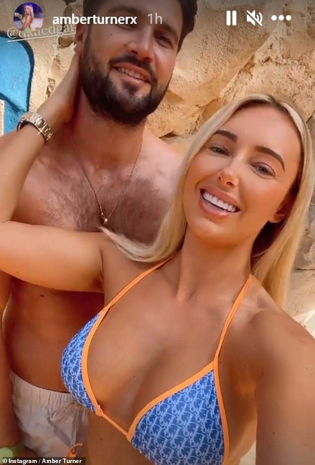 Loved-up:Earlier this month, TV star Amber enjoyed a business trip to Dubai with her boyfriend Dan Edgar