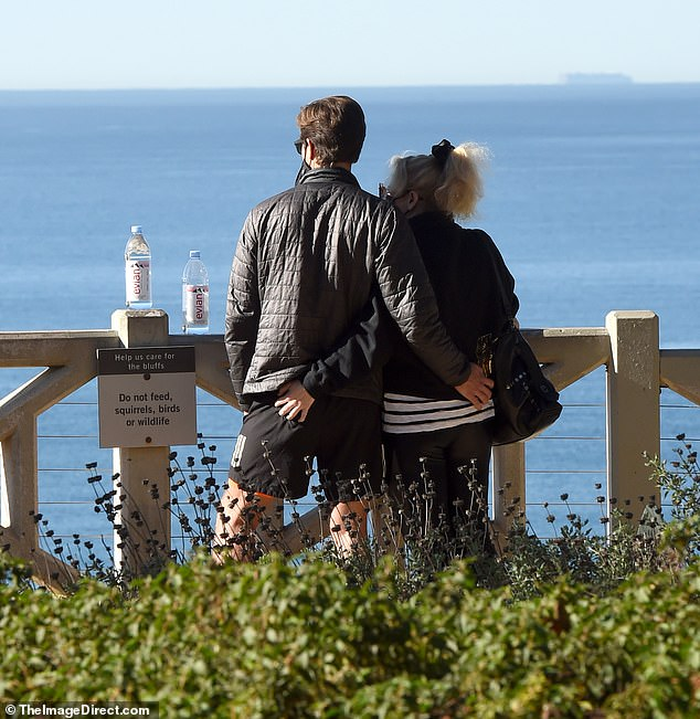 Just the two of us: The couple put on an amorous display as they gazed out towards the ocean