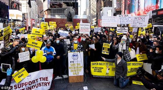 Dozens gathered in Times Square on Tuesday to protest the governor's decision