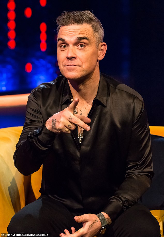 Mercury rising:Robbie Williams claims he nearly died from mercury and arsenic poisoning while on a diet high in fish