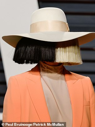 Math and Sia!  In an interview with Studio 10 on Thursday, the Australian songwriter removed her trademark wigs (pictured) to show off her natural beauty when she spoke to Angela Bishop about her famous film, Music