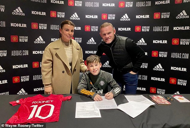 Wayne Rooney and his wife Coleen joined Kai as he signed for Manchester United