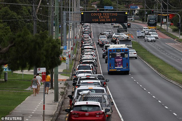 Vehicles queue for a drive-through coronavirus disease (COVID-19) testing clinic in the Warriewood suburb of Sydney on Friday