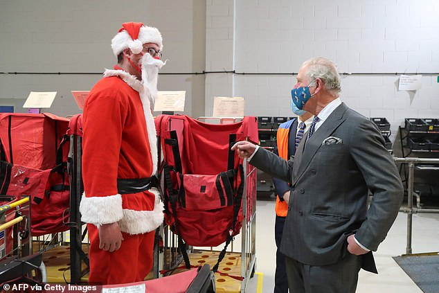 Prince Charles, 71, met with postal workers dressed in festive costumes today during a visit to the Royal Mail delivery office