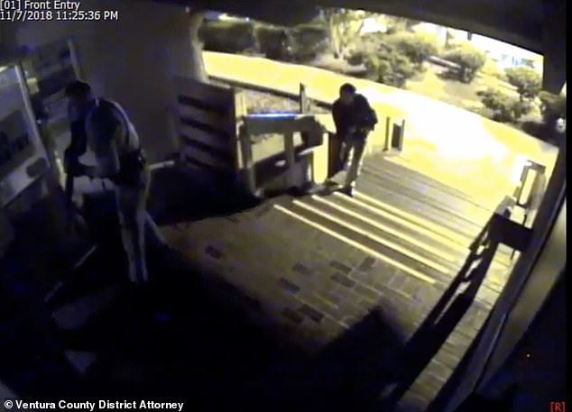 Helus and Barrett are seen entering the venue from the front entry cameras