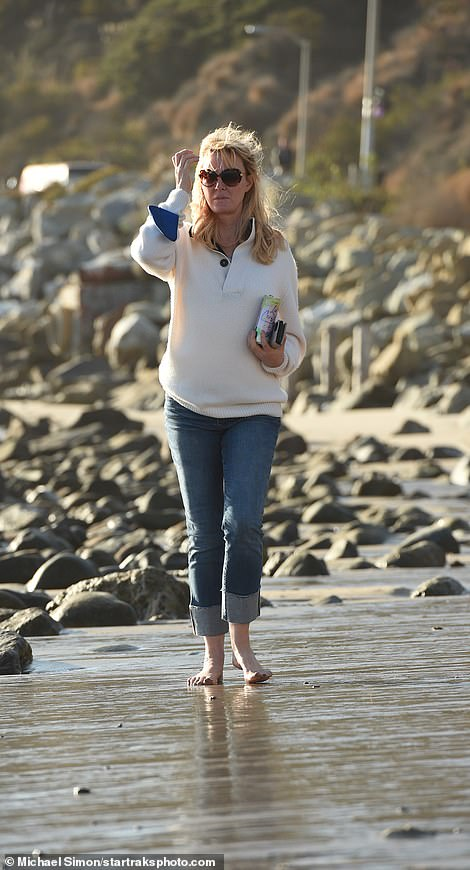 Celebrity chef Sandra Lee has been pictured taking a solo walk by her oceanfront home in Malibu for the first time since she revealed she has moved out of the New York home once shared with ex Governor Andrew Cuomo, pictured above