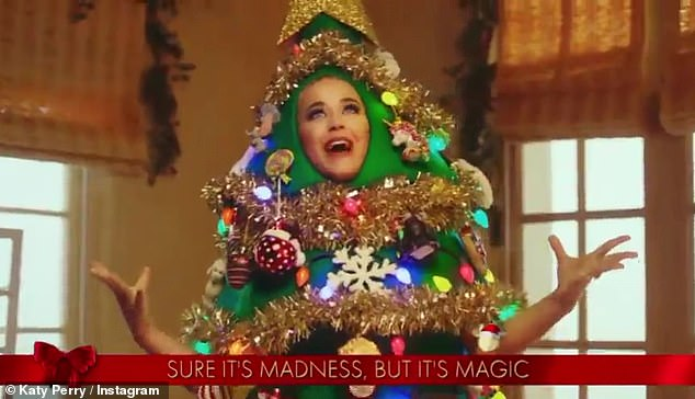 Christmas 'TREE(T)': The always eccentric Katy Perry, 36, is spreading some Christmas cheer in honor of the Disney Holiday Sing-along as she croons while dressed up in an elaborate tree costume