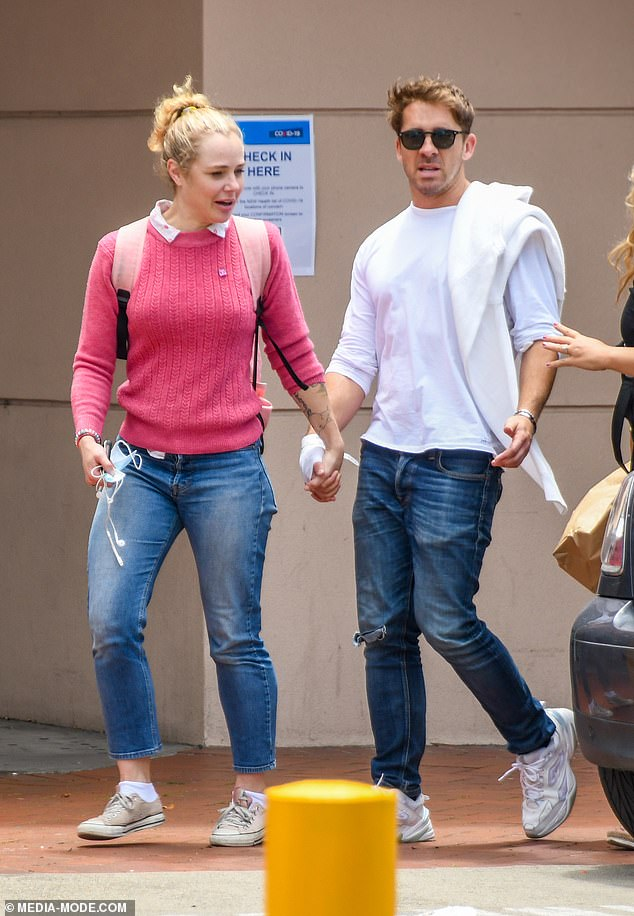 Hospital visit: On November 21, photos emerged of Hugh leaving hospital with a bandage on his right hand and bracelets on his left wrist. The Five Bedrooms star was flanked by his close pal, actress Jessica Marais (left) who held his hand and led him to a parked car nearby