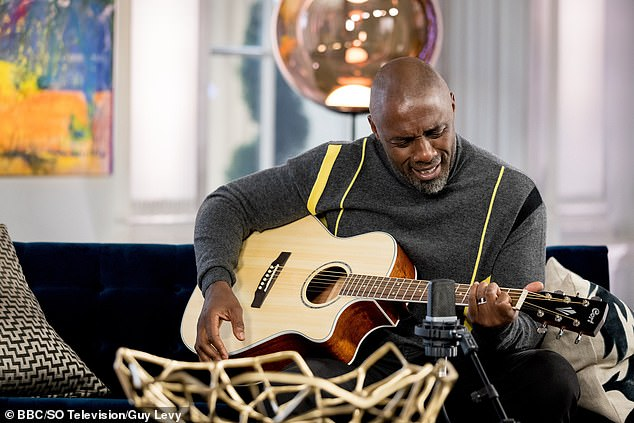 Strumming along: Idris couldn't help but show off his new skills as a guitarist himself