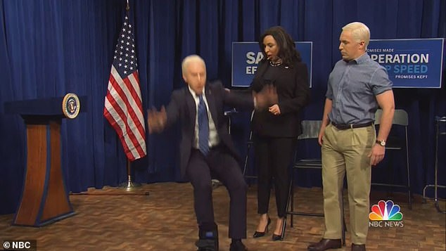 Biden then lands on his feet beside Harris as he tries to project business as usual following his injury