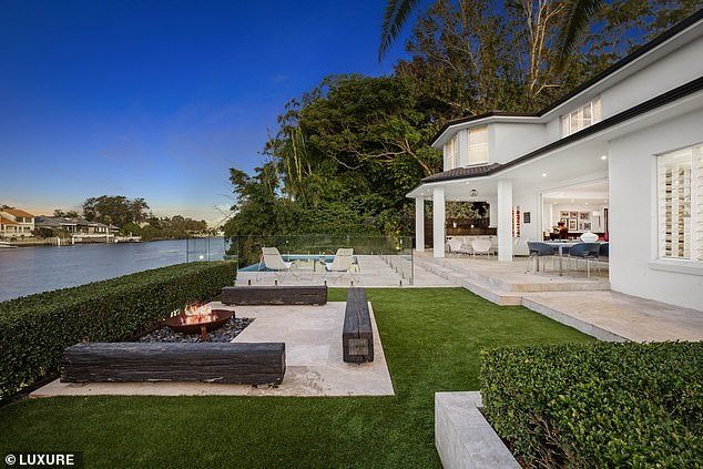 Stunning: The large home has a white facade, manicured gardens, and its own jet ski ramp and timber jetty - and was purchased by Tammy in August