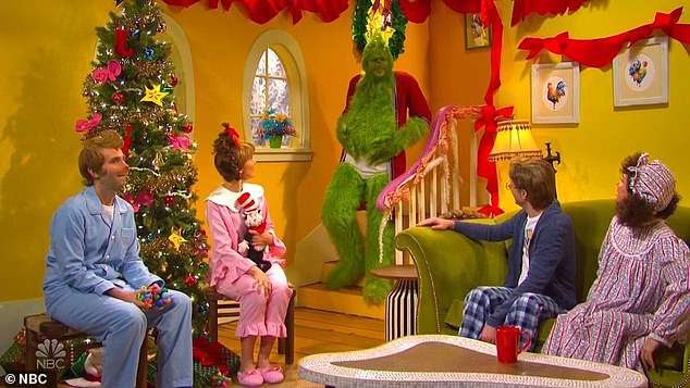 House guest: The blushing parents assure their kids not to worry about it, just as Davidson's hairy green Grinch comes downstairs in their dad's bathrobe in underwear