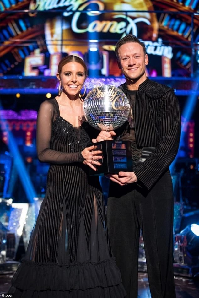 Victory: Kevin last lifted the glitterball trophy in 2018 alongside now girlfriend Stacey Dooley, after making it into the grand final four times