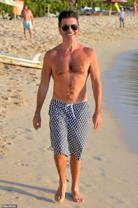 Simon Cowell, 61, is now walking FIVE MILES a day after breaking his back in electric bike accident