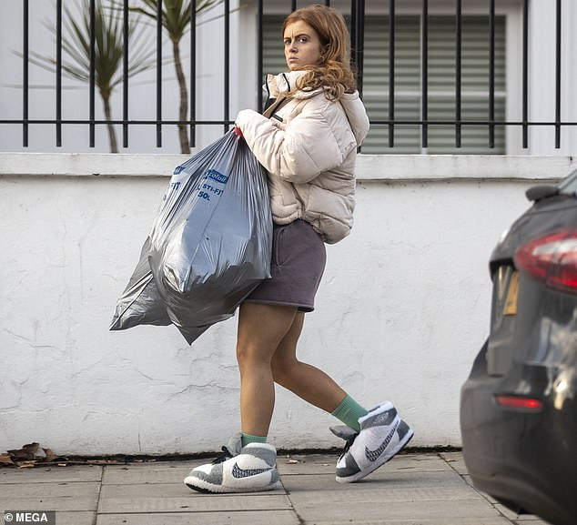 Strictly's Maisie Smith cuts a casual figure in shorts and a padded jacket to take the bins out