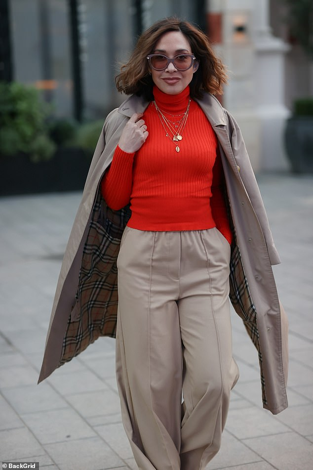 Chic:Myleene, who is one of the government's essential workers as a radio host, donend a chic scarlet sweater paired with chic cream flares as she strutted