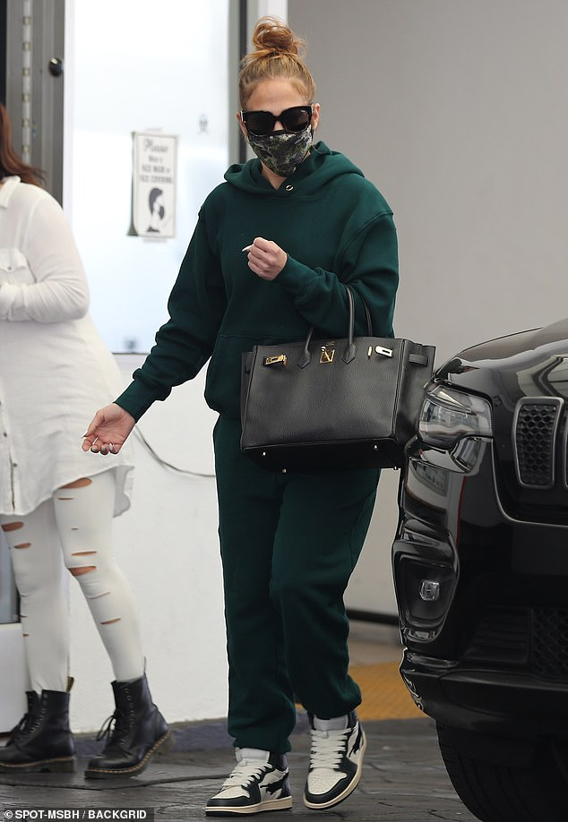 Skin solutions: Jennifer Lopez, 51, was out in Beverly Hills while rocking a turquoise tracksuit and carrying a Birkin bag on Saturday