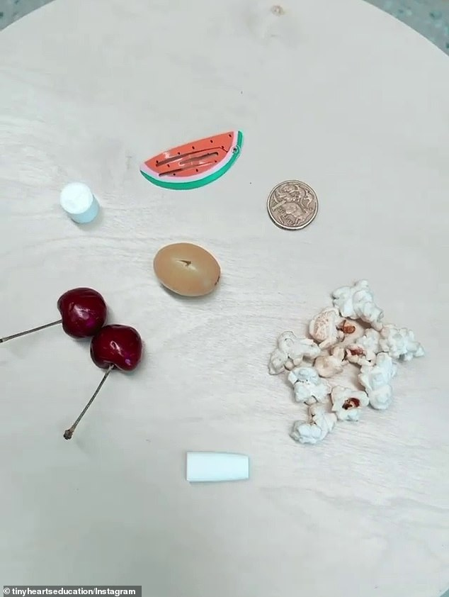 Previously, parenting organisation Tiny Hearts shared the foods including a cherry, popcorn, a grape, a coin and other toys that serve as choking hazards (pictured)